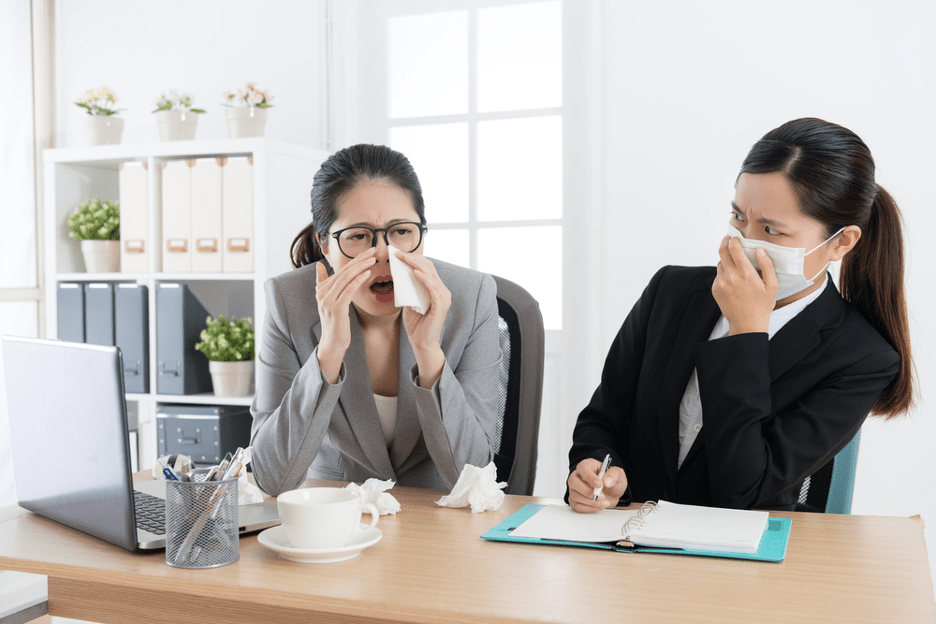 ladies sneezing in office